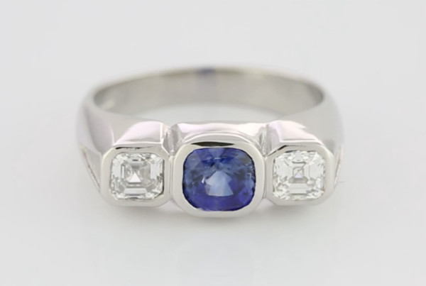 01 Blue Sapphire And Diamonds In Platinum Ring With Blue Sapphire Em Cut With Two Em Cut Diamonds