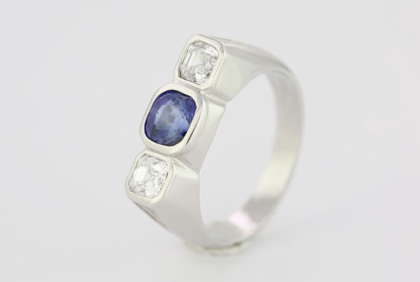 2 Blue Sapphire And Diamonds In Platinum Ring With Blue Sapphire Em Cut With Two Em Cut Diamonds