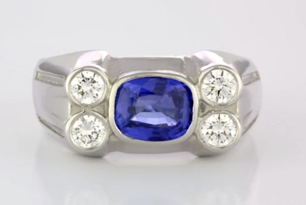A Fine Blue Sapphire Cushion Cut With Four Round Brilliant Cut Diamonds