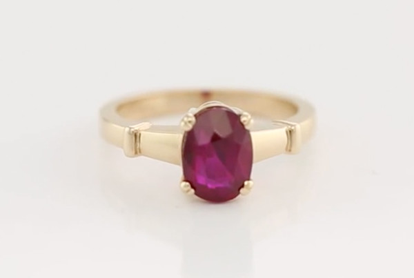 A Very Fine Ruby Set In Red Gold