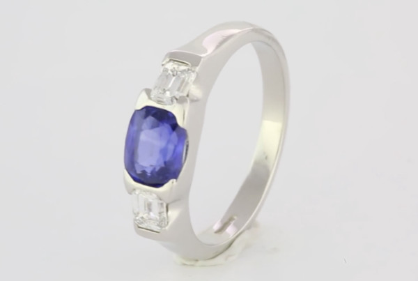 Blue Sapphire And Diamonds In Platinum Ring, A Fine Blue Sapphire Cushion Cut With Two Emerald Cut Diamonds