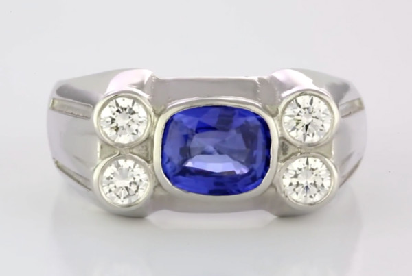 Blue Sapphire And Diamonds In Platinum Ring, A Fine Blue Sapphire Cushion Cut with Four Round Brilliant Cut Diamonds