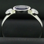 Blue Sapphire And Diamonds In Platinum Ring, A Fine Blue Sapphire Oval Cut With Two Round Brilliant Cut Diamonds