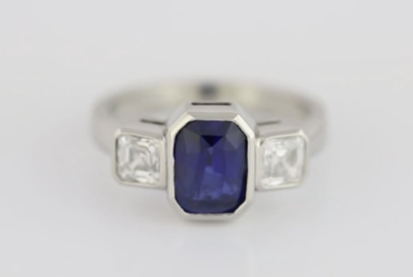 Blue Sapphire And Diamonds In Platinum Ring, Blue Sapphire Em cut With Two Em Cut Diamonds
