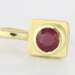 Ruby Round Shape Set In Gold Square Pendant