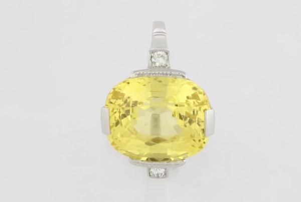 Yellow Sapphire And Diamonds Set In Platinum Ring