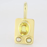 Yellow Sapphire Oval Shape And Two Real Salt Water Pearls Set In Gold Pendant