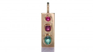 Green Sapphire And Two Rubies Placed On A Gold Pendant