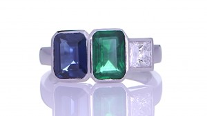 Green Sapphire, Blue Saphhore And A Diamond Placed On A Silver Ring