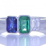Green Sapphire, Blue Sapphire And A Diamond Placed On A Silver Ring