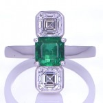 Green Sapphire With Two Diamonds Placed On A Silver Ring