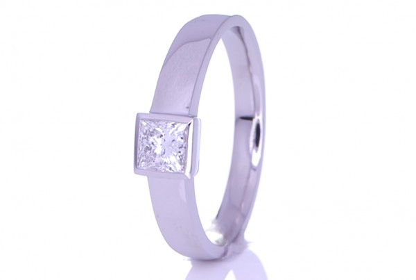 Square Diamond Placed On A Silver Ring