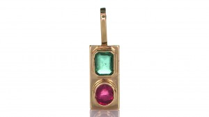 Two Green Sapphire And A Ruby Placed On A Gold Pendant