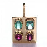 Two Green Sapphire And Two Rubies Placed On A Gold Pendant