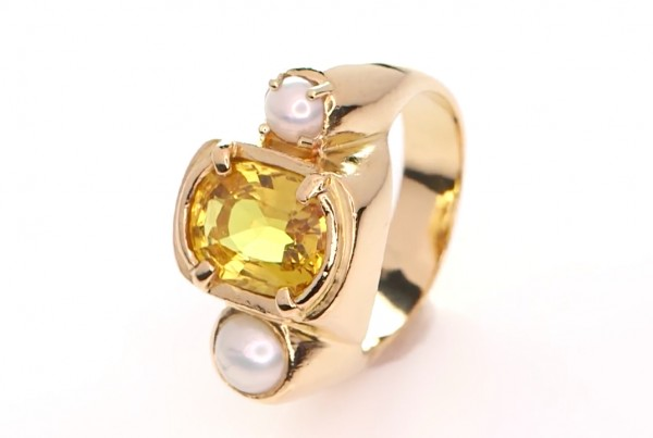Yellow Sapphire With 2 White Pearls On A Golden Ring