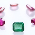 Collection Of Rubies And A Green Emerald