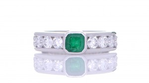 Green Emerald Ring Surrounded By White Diamonds
