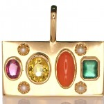Red Sea Coral, Four White Pearls, Ruby, Yellow Sapphire And A Green Emerald Placed On A Golden Pendant