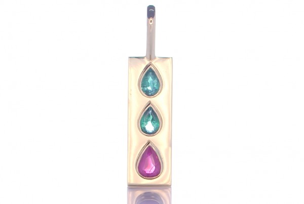 Two Green Emeralds And A Ruby Placed On A Gold Pendant