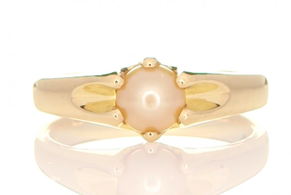 White Pearl Placed In A Golden Ring