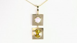 Yellow Sapphire And A White Pearl Placed On Individual Golden Pendant