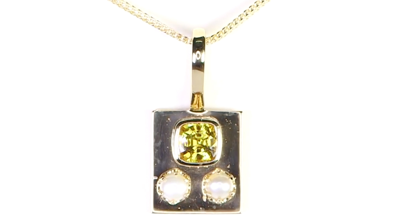 Yellow Sapphire With Two White pearls Placed On A Golden Pendant