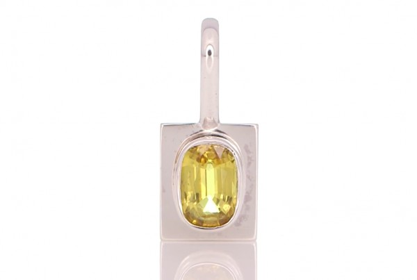 Yellow Sapphire placed On A Silver Pendant