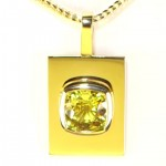 Golden Sapphire Mounted On A Golden Pendant