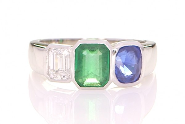 Green Emerald, Blue Sapphire And A Diamond On A Silver Ring