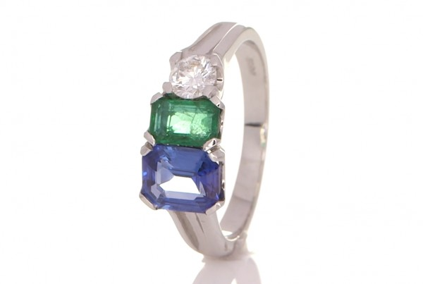 Green Emerald, Blue Sapphire And Two Diamonds On A Silver Ring