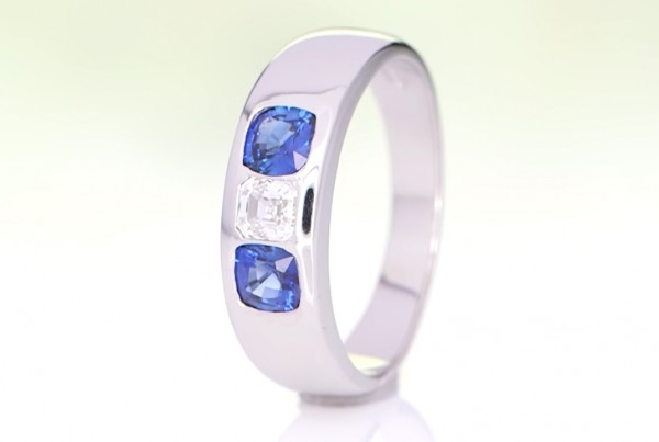 Two Blue Sapphires With A Diamond