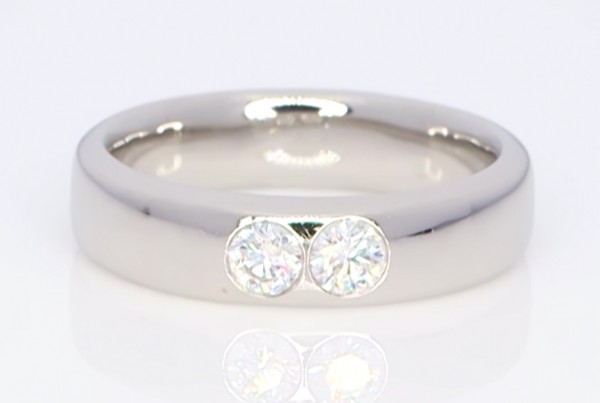 Two Diamonds In A Silver Ring