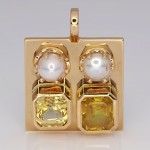 Two White Pearls With A Yellow And Golden Sapphires On A Golden Pendant
