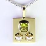 Two White Pearls With A Yellow Sapphire On A Golden Pendant