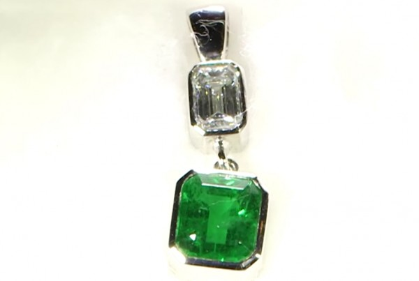 A Diamond With A Green Emerald