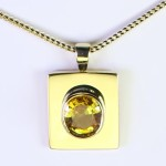 Golden Yellow Sapphire Mounted In A Golden Pendant