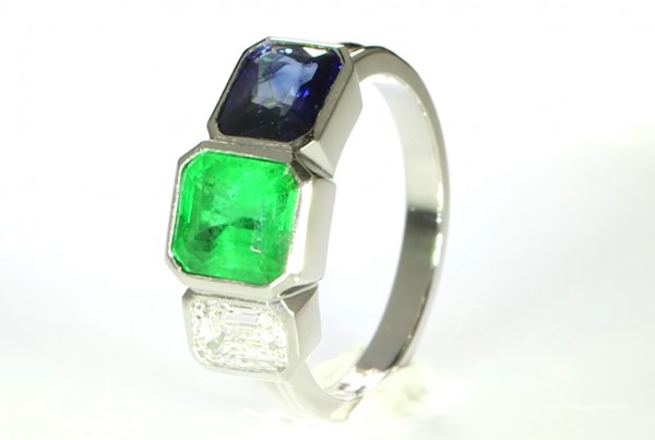 Green Emerald, Blue Sapphire & A Diamond Mounted in A Platinum Ring