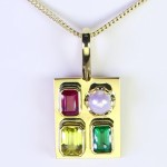 Ruby, Yellow Sapphire, Green Emerald And A White Pearl Mounted On A Golden Pendant