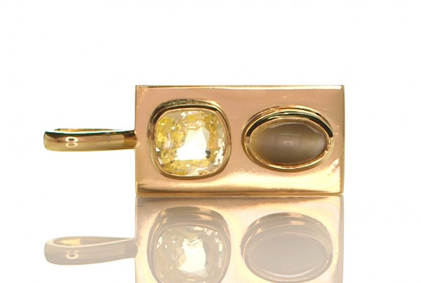 Golden Yellow Sapphire With Cat's Eye Mounted On A Golden Pendant