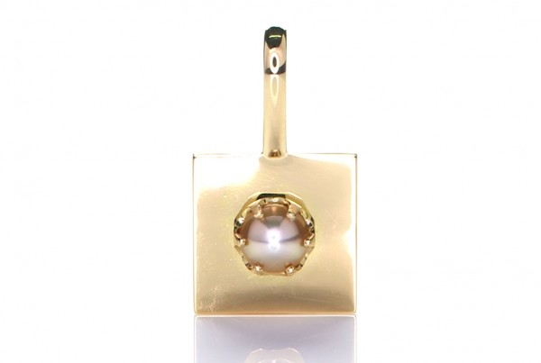 White Pearl Mounted On A Golden Pendant