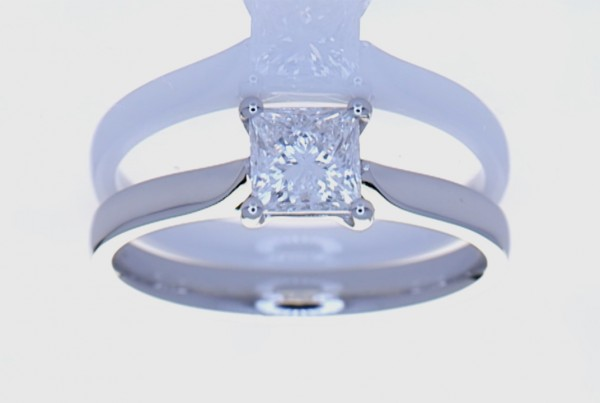 White Square Diamond Ring Mounted On A Platinum Ring