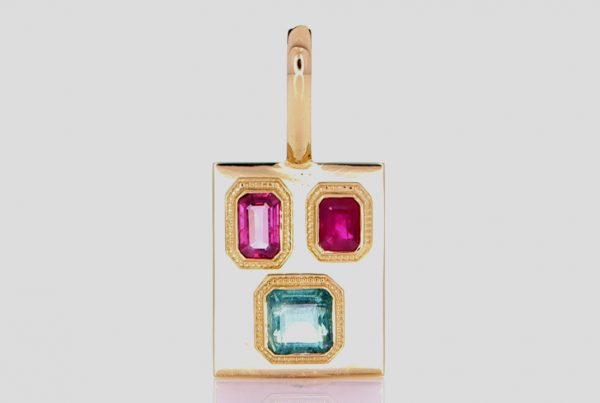 Two Rubies And A Green Emerald Mounted On A Golden Pendant