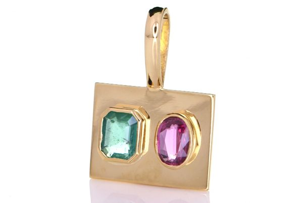 Green Emerald With Ruby Mounted Onto A Golden Pendant