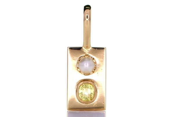 Golden Pendant With White Pearl And A Yellow Sapphire