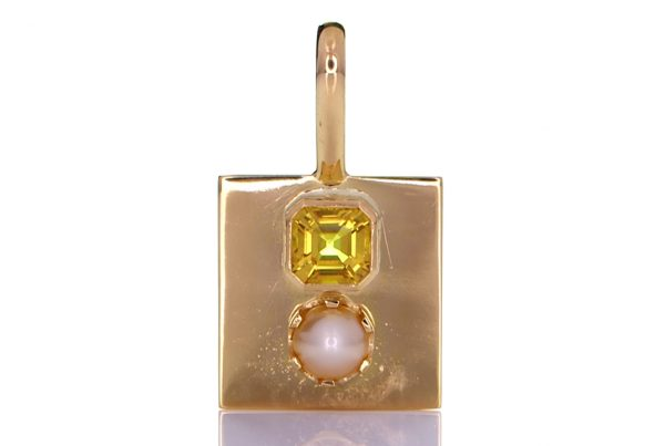 Golden Pendant With Yellow Sapphire And A White Pearl
