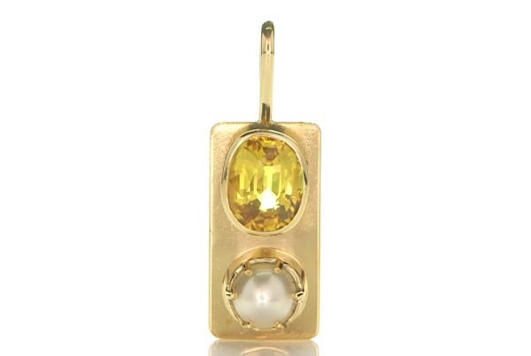 Golden Pendant With Golden Sapphire And A White Pearl