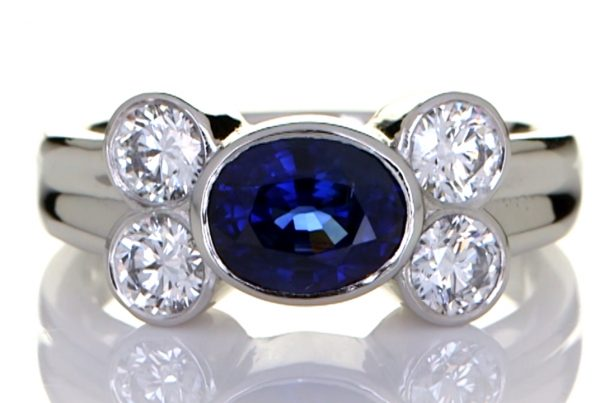 Platinum Ring With Four Diamonds And Blue Sapphire