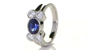 Platinum Ring With Four Diamonds And Green Sapphire
