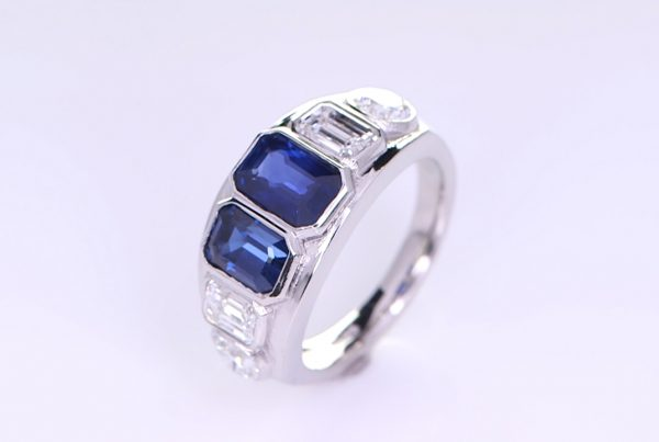 Platinum Ring With Two Blue Sapphires and Four Diamonds