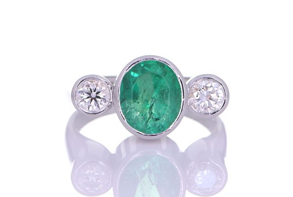 Platinum Ring With Two Diamonds And A Green Sapphire